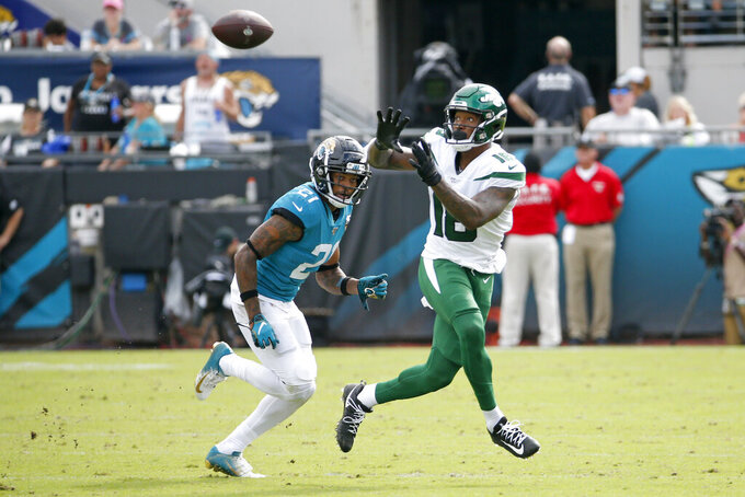 New York Jets wide receiver Demaryius Thomas, right, makes a reception in front of Jacksonville Jaguars cornerback A.J. Bouye, left, during the second half of an NFL football game, Sunday, Oct. 27, 2019, in Jacksonville, Fla. (AP Photo/Stephen B. Morton)