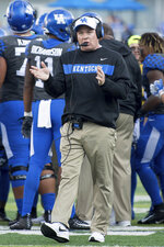FILE- In this Saturday, Nov. 3, 2018, file photo, Kentucky head coach Mark Stoops paces on the field during the first half an NCAA college football game against Georgia in Lexington, Ky. Kentucky's biggest challenge may come Saturday when the Wildcats close their SEC schedule at Tennessee, where they have lost 16 straight and haven't won since 1984. (AP Photo/Bryan Woolston, File)