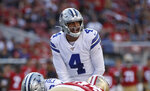 Dallas Cowboys quarterback Dak Prescott (4) stands behind center during the first half of the team's NFL preseason football game against the San Francisco 49ers in Santa Clara, Calif., Saturday, Aug. 10, 2019. (AP Photo/Jeff Chiu)