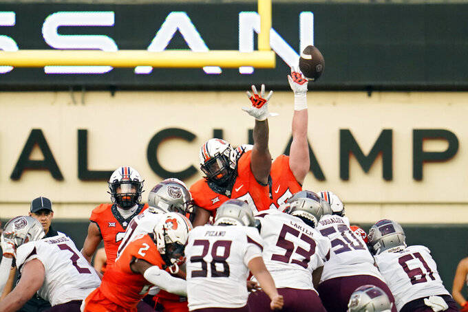 Missouri State kicker Jose Pizano (38) kicks a field goal over the Oklahoma State defense in the first half of an NCAA college football game, Saturday, Sept. 4, 2021, in Stillwater, Okla. (AP Photo/Sue Ogrocki)