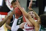 Wisconsin's Trevor Anderson tries to shoot during the second half of an NCAA college basketball game against Wisconsin-Green Bay Tuesday, Dec. 1, 2020, in Madison, Wis. (AP Photo/Morry Gash)