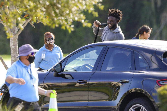 Tampa Bay Buccaneers NFL football wide receiver Chris Godwin, top, is seen leaving a private workout Tuesday, June 23, 2020, at Berkeley Preparatory School in Tampa, Fla. (Chris Urso/Tampa Bay Times via AP)