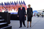 President Donald Trump and first lady Melania Trump arrive to speak before they board Air Force One at Andrews Air Force Base, Md., Wednesday, Jan. 20, 2021.(AP Photo/Manuel Balce Ceneta)