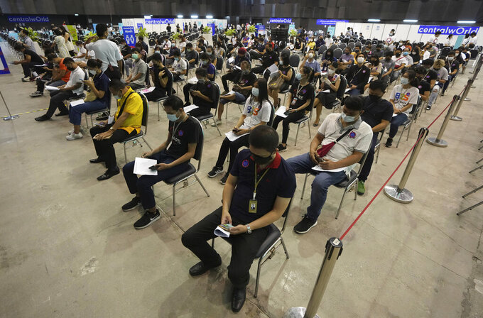 People sit and wait after receiving the Sinovac COVID-19 vaccine to be sure of no side effects in Bangkok, Thailand, Monday, May 31, 2021. (AP Photo/Sakchai Lalit)