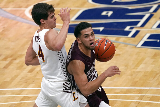 Southern Illinois' Steven Verplancken Jr., right, heads to the basket as Loyola of Chicago's Braden Norris (4) defends during the first half of an NCAA college basketball game in the quarterfinal round of the Missouri Valley Conference men's tournament Friday, March 5, 2021, in St. Louis. (AP Photo/Jeff Roberson)