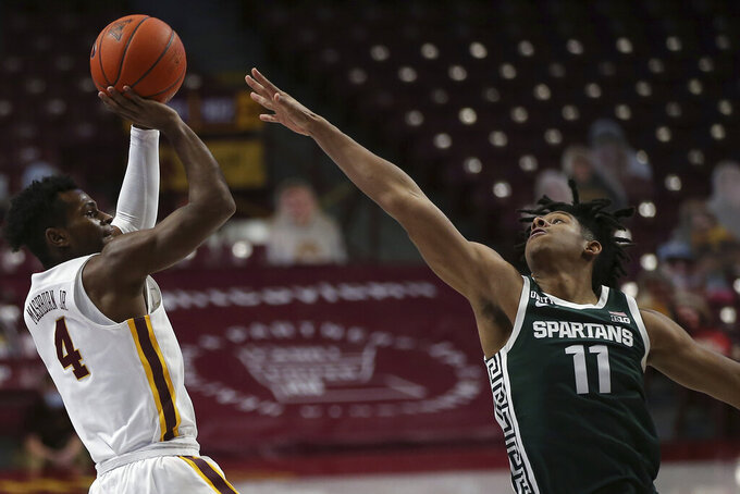 Minnesota's Jamal Mashburn Jr. (4) shoots as Michigan State's A.J. Hoggard (11) defends during the first half of an NCAA college basketball game Monday, Dec. 28, 2020, in Minneapolis. (AP Photo/Stacy Bengs)