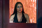 This image released by USA Network shows Rosario Dawson, as Allegra Dill, in a scene from her new series