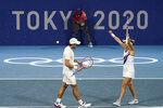 The Russian Olympic Committee mixed doubles team of Elena Vesina, right, and Aslan Karatsev celebrate after winning their semifinals match of the tennis competition at the 2020 Summer Olympics, Friday, July 30, 2021, in Tokyo, Japan. (AP Photo/Seth Wenig)
