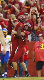Iowa State tight end Chase Allen, right, hoists up wide receiver Deshaunte Jones, left, after Jones ran in a touchdown during the first half of an NCAA college football game, Saturday, Sept. 1, 2018, in Ames, Iowa. (AP Photo/Matthew Putney)