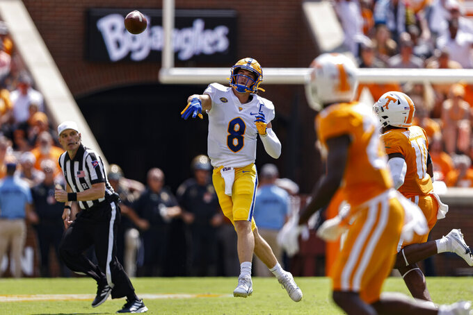 Pittsburgh quarterback Kenny Pickett (8) throws to a receiver during the first half of an NCAA college football game against Tennessee, Saturday, Sept. 11, 2021, in Knoxville, Tenn. (AP Photo/Wade Payne)
