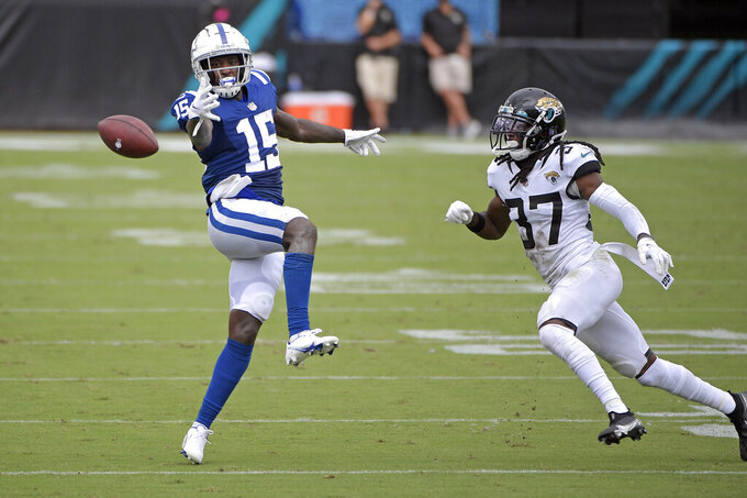 Indianapolis Colts wide receiver Parris Campbell (15) drops a pass in front of Jacksonville Jaguars cornerback Tre Herndon (37) during the first half of an NFL football game, Sunday, Sept. 13, 2020, in Jacksonville, Fla. (AP Photo/Phelan M. Ebenhack)