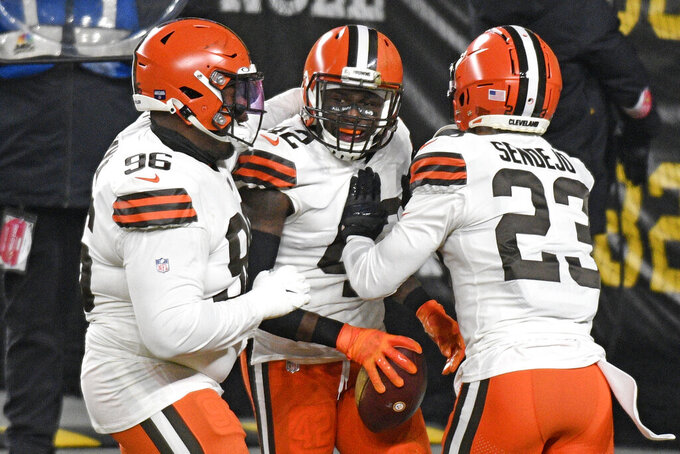 Cleveland Browns strong safety Karl Joseph (42) celebrates after recovering a fumble in the end zone for a touchdown during the first half of an NFL wild-card playoff football game against the Pittsburgh Steelers in Pittsburgh, Sunday, Jan. 10, 2021. (AP Photo/Don Wright)