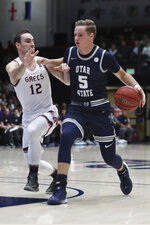 Utah State guard Sam Merrill (5) drives against Saint Mary's guard Tommy Kuhse (12) during the first half of an NCAA college basketball game in Moraga, Calif., Friday, Nov. 29, 2019. (AP Photo/Jed Jacobsohn)