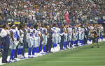 "FILE - In this Oct. 6, 2019, file photo, the Dallas Cowboys stand for the national anthem before playing the Green Bay Packers in an NFL football game in Arlington, Texas. Cowboys quarterback Dak Prescott wants his teammates to decide for themselves whether to protest during the national anthem. Defensive lineman Tyrone Crawford says they have the ""green light"" to do so. Owner Jerry Jones hasn't said in so many words, but it appears his hard-line stance over his players standing during the anthem has eased amid a national reckoning over racial justice. (AP Photo/Ron Jenkins, File)"
