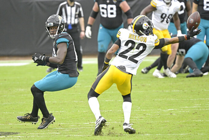 Pittsburgh Steelers cornerback Steven Nelson (22) tries to incept a pass intended for Jacksonville Jaguars wide receiver Chris Conley (18) during the first half of an NFL football game, Sunday, Nov. 22, 2020, in Jacksonville, Fla. (AP Photo/Phelan M. Ebenhack)
