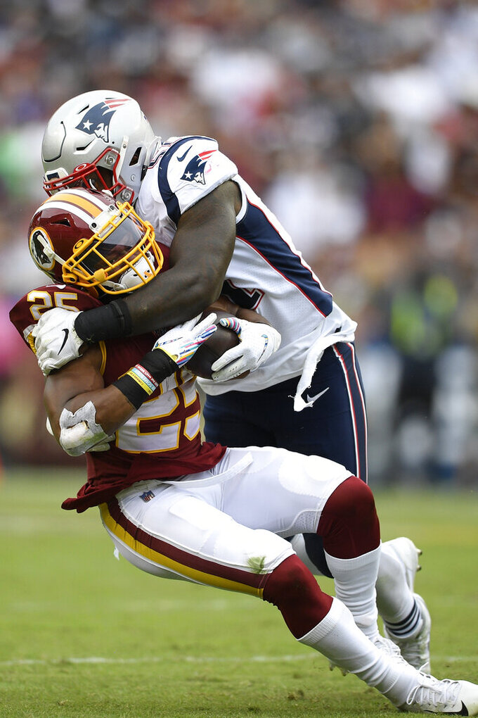 New England Patriots linebacker Ja'Whaun Bentley (51) hits Washington Redskins running back Chris Thompson (25) during the second half of an NFL football game, Sunday, Oct. 6, 2019, in Washington. (AP Photo/Nick Wass)