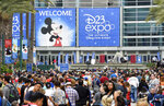 FILE - In this July 14, 2017, file photo a crowd of people wait to enter the D23 Expo as crews do interviews outside the Anaheim Convention Center in Anaheim, Calif. Members of Disney's free D23 fan club were eligible to buy three years of Disney Plus service up front for the price of two years. (Jeff Gritchen/The Orange County Register via AP, File)