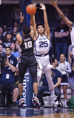 Butler forward Christian David (25) tries to block the shot of Providence guard A.J. Reeves (10) during the first half of an NCAA college basketball game, Tuesday, Feb. 26, 2019, in Indianapolis. (AP Photo/Doug McSchooler)