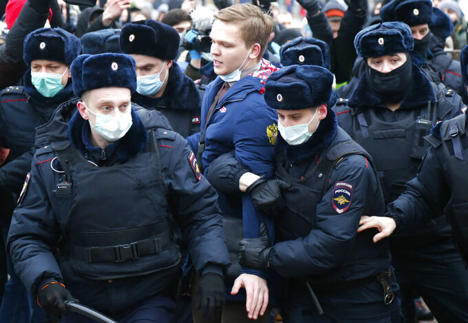 Police detain a man during a protest against the jailing of opposition leader Alexei Navalny in Moscow, Russia, Saturday, Jan. 23, 2021. Russian police are arresting protesters demanding the release of the top Russian opposition leader at demonstrations (AP Photo/Alexander Zemlianichenko)