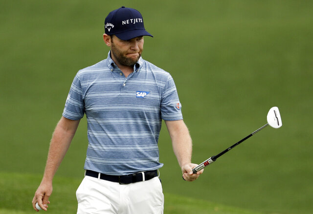 FILE - In this April 11, 2019, file photo, Branden Grace, of South Africa, reacts to a birdie on the second hole during the first round for the Masters golf tournament in Augusta, Ga. Grace tested positive for the coronavirus Saturday, Aug. 1, 2020, a double blow to the South African who was one birdie out of the lead at the Barracuda Championship and now can't play next week in the PGA Championship.  (AP Photo/Chris Carlson, File)