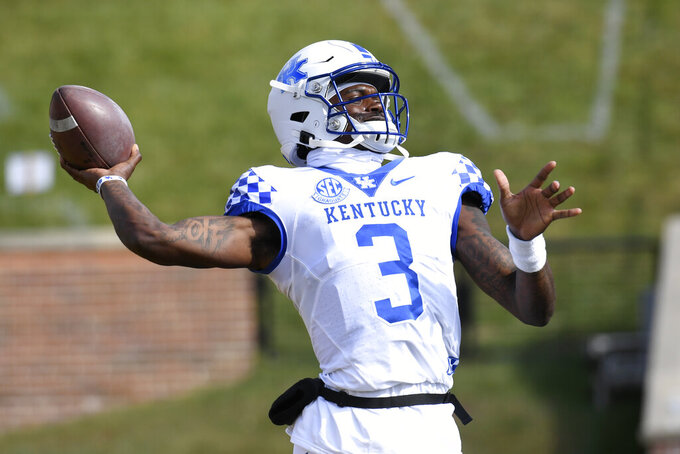 Kentucky quarterback Terry Wilson warms up before the start of an NCAA college football game against Missouri Saturday, Oct. 24, 2020, in Columbia, Mo. (AP Photo/L.G. Patterson)