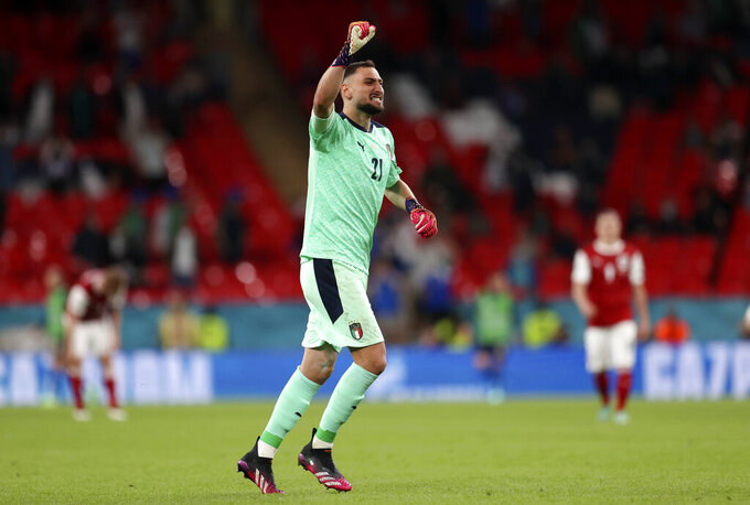 Italy's goalkeeper Gianluigi Donnarumma celebrates during the Euro 2020 soccer championship round of 16 match between Italy and Austria at Wembley stadium in London, Saturday, June 26, 2021. (Catherine Ivill/Pool via AP)