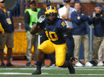 Michigan linebacker Devin Bush celebrates a stop against Nebraska in the first half of an NCAA football game in Ann Arbor, Mich., Saturday, Sept. 22, 2018. (AP Photo/Paul Sancya)