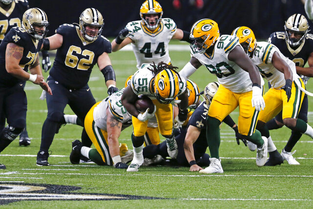 Green Bay Packers outside linebacker Za'Darius Smith (55) recovers a fumble in the second half of an NFL football game against the New Orleans Saints in New Orleans, Sunday, Sept. 27, 2020. (AP Photo/Brett Duke)