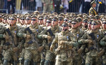 Ukrainian soldiers march along main Khreshchatyk Street during a military parade to celebrate Independence Day in Kyiv, Ukraine, Tuesday, Aug. 24, 2021. Ukraine mark the 30th anniversary of its independence. (AP Photo/Efrem Lukatsky)
