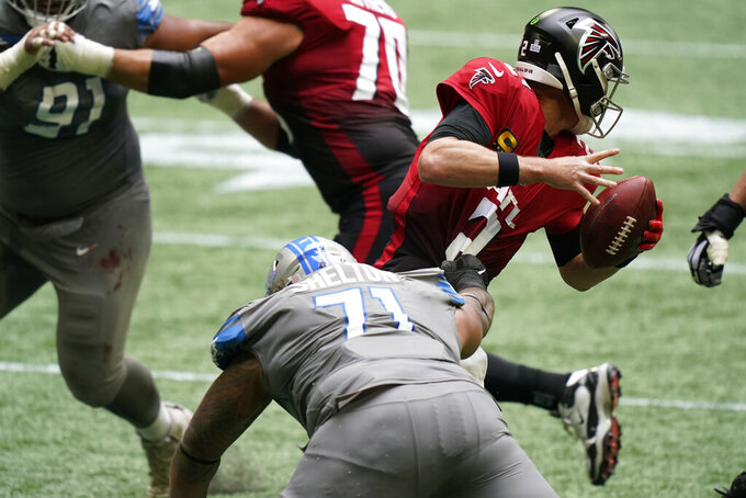 Atlanta Falcons quarterback Matt Ryan (2) moves away from Detroit Lions nose tackle Danny Shelton (71) during the first half of an NFL football game, Sunday, Oct. 25, 2020, in Atlanta. (AP Photo/Brynn Anderson)