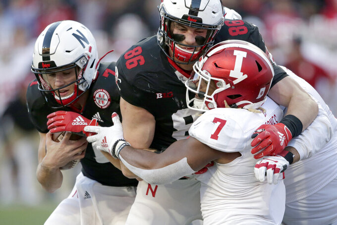Nebraska quarterback Luke McCaffrey (7) carries the ball as tight end Jack Stoll (86) blocks Indiana linebacker Reakwon Jones (7)] during the second half of an NCAA college football game in Lincoln, Neb., Saturday, Oct. 26, 2019. Indiana won 38-31. (AP Photo/Nati Harnik)