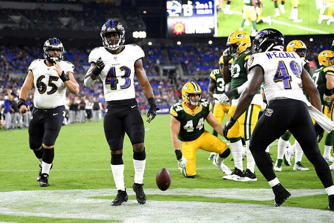 Baltimore Ravens running back Justice Hill (43) celebrates after scoring a touchdown run against the Green Bay Packers during the second half of an NFL football preseason game, Thursday, Aug. 15, 2019, in Baltimore. (AP Photo/Nick Wass)