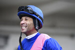 This photo provided by NYRA shows Kendrick Carmouche smiling in the paddock at Aqueduct Racetrack in the Queens borough of New York on Jan. 24, 2020. Carmouche is set to ride Bourbonic in the Kentucky Derby, the first Black jockey in the race since 2013. (NYRA Photos/Coaglianese via AP)