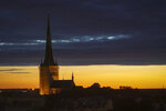 Dusk falls over Estonia's medieval capital, Tallinn, Thursday, June 27, 2019. The small Baltic nation spent more than a decade fighting fentanyl drug abuse. Although police won the war on fentanyl the market shifted further to synthetic drugs. (AP Photo/David Keyton)