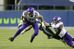 Minnesota Vikings linebacker Eric Wilson (50) returns an interception against the Seattle Seahawks during the second half of an NFL football game, Sunday, Oct. 11, 2020, in Seattle. (AP Photo/John Froschauer)