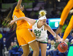 Notre Dame's Sam Brunelle (33) tries to get past Tennessee's Jessie Rennie (10) during an NCAA college basketball game Monday, Nov. 11, 2019 at Purcell Pavilion in South Bend, Ind. (Michael Caterina/South Bend Tribune via AP)