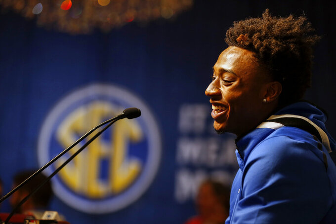 Kentucky's Ashton Hagans speaks during the Southeastern Conference NCAA college basketball media day, Wednesday, Oct. 16, 2019, in Birmingham, Ala. (AP Photo/Butch Dill)