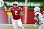 Nebraska quarterback Adrian Martinez (2) throws a pass as South Alabama safety Tré Young (5) closes in during the first half of an NCAA college football game in Lincoln, Neb., Saturday, Aug. 31, 2019. (AP Photo/Nati Harnik)