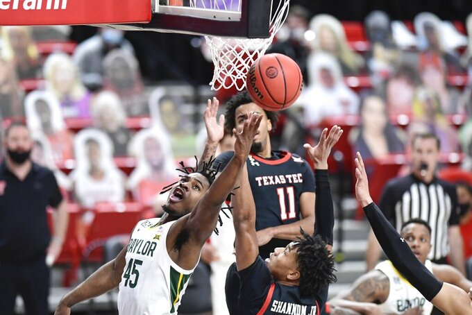 Baylor's Davion Mitchell (45) shoots the ball during the first half of an NCAA college basketball game against Texas Tech in Lubbock, Texas, Saturday, Jan. 16, 2021. (AP Photo/Justin Rex)