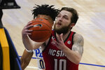 North Carolina State's Braxton Beverly (10) shoots in front of Pittsburgh's Ithiel Horton during the first half of an NCAA college basketball game, Wednesday, Feb. 17, 2021, in Pittsburgh. (AP Photo/Keith Srakocic)