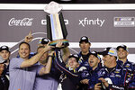 William Byron, center, with sponsors and crew members, lifts the trophy after winning the second of two NASCAR Daytona 500 qualifying auto races at Daytona International Speedway, Thursday, Feb. 13, 2020, in Daytona Beach, Fla. (AP Photo/Terry Renna)
