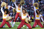 "FILE - Then-Washington Redskins cheerleaders perform during an NFL football game against the Philadelphia Eagles in Landover, Md., in this Sunday, Dec. 15, 2019, file photo.  The Washington Football Team will not have cheerleaders for the 2021 season as part of an organizational rebranding. Washington hired Petra Pope, who managed the ""Laker Girls"" and brings three decades of NBA experience as an adviser to take on the task of reinventing the group.(AP Photo/Mark Tenally, File)"