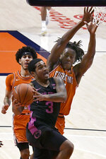 Penn State guard Sam Sessoms (3) drives to the basket as Illinois guards Ayo Dosunmu, right, and Andre Curbelo defend during the first half of an NCAA college basketball game Tuesday, Jan. 19, 2021, in Champaign, Ill. (AP Photo/Holly Hart)