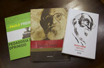 This Feb. 5, 2019 photo shows three books by Paulo Freire at a public library, in Rio de Janeiro, Brazil. For the Jair Bolsonaro government, the ideological battle on education begins with the removal of Freire's legacy in schools. Freire, who died in 1997, was one of the founders of critical pedagogy, a movement that promotes the