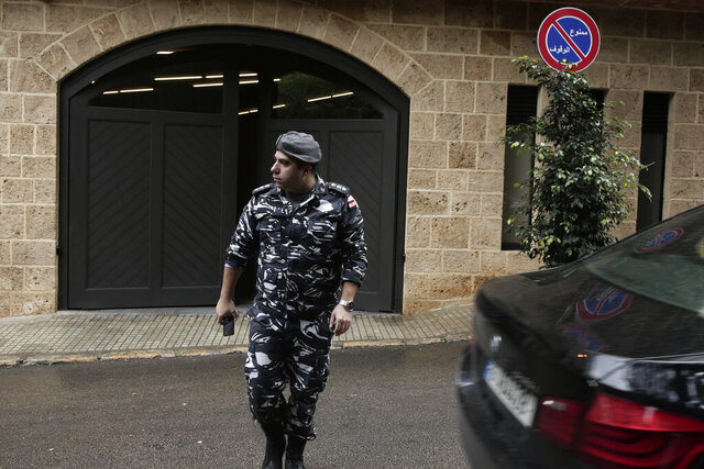 A policeman leaves the residence of former Nissan Chairman Carlos Ghosn on Tuesday, Dec. 31, 2019 in Beirut, Lebanon. A close friend says Ghosn, who is awaiting trial in Japan, has arrived in Beirut. It was not clear how Ghosn, who is of Lebanese origins, left Japan where he is under surveillance and is expected to face trial in April 2020. (AP Photo/Maya Alleruzzo)