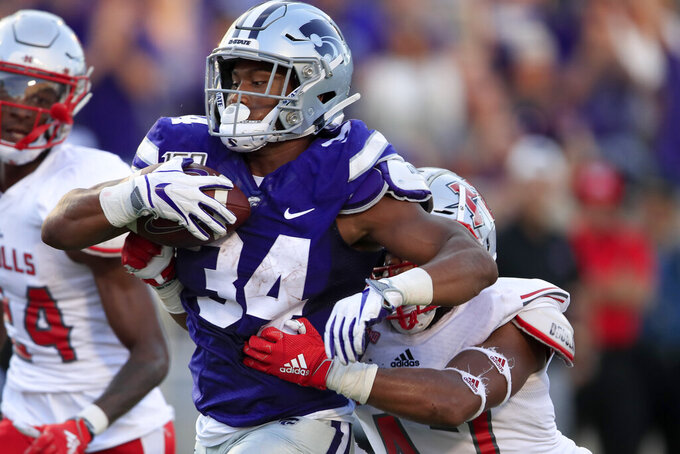 Kansas State running back James Gilbert (34) makes it to the end zone for a touchdown, before being tackled by Nicholls State linebacker Allen Pittman (47) during the first half of an NCAA college football game in Manhattan, Kan., Saturday, Aug. 31, 2019. (AP Photo/Orlin Wagner)