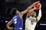 Villanova guard Phil Booth (5) goes up for a shot against Seton Hall guard Anthony Nelson (2) during the first half of an NCAA college basketball game in the championship of the Big East Conference tournament, Saturday, March 16, 2019, in New York. (AP Photo/Julio Cortez)