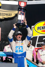 Austin Cindric (22) celebrates after winning the NASCAR Xfinity Series auto race at Indianapolis Motor Speedway in Indianapolis, Saturday, Aug. 14, 2021. (AP Photo/Darron Cummings)