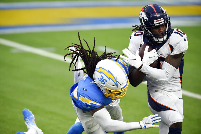 Denver Broncos wide receiver Jerry Jeudy (10) runs next to Los Angeles Chargers strong safety Jahleel Addae after a catch during the second half of an NFL football game Sunday, Dec. 27, 2020, in Inglewood, Calif. (AP Photo/Kelvin Kuo)