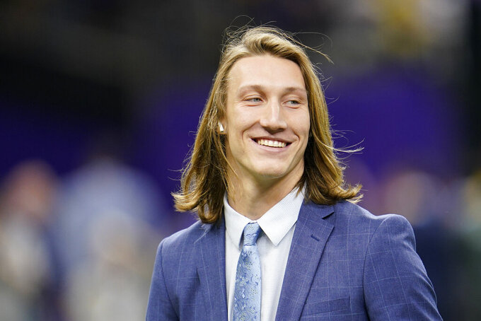 Clemson quarterback Trevor Lawrence arrives before a NCAA College Football Playoff national championship game against LSU Monday, Jan. 13, 2020, in New Orleans. (AP Photo/David J. Phillip)